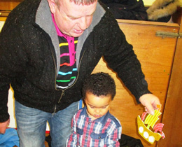 Photograph of father and son taking part in a pirate night at Kelloholm Primary