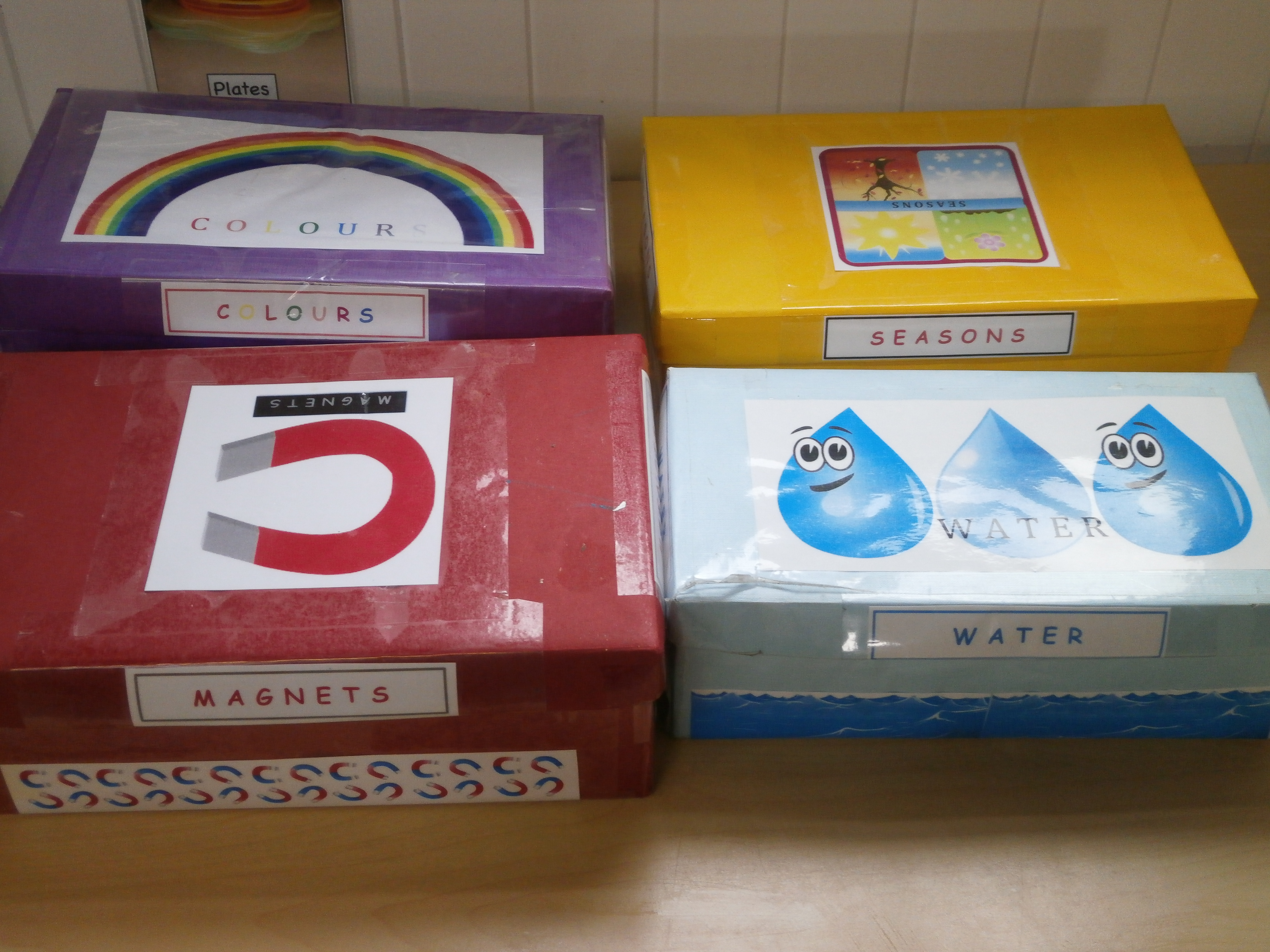 shoe boxes with colourful paper