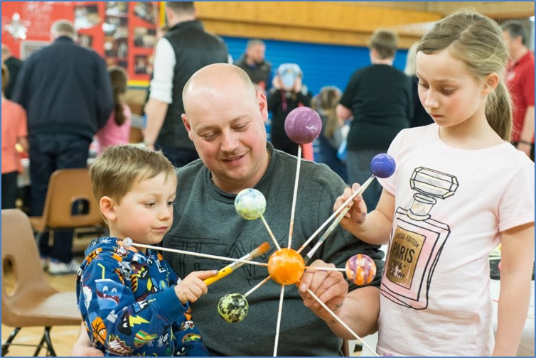 Adult and children at STEM event